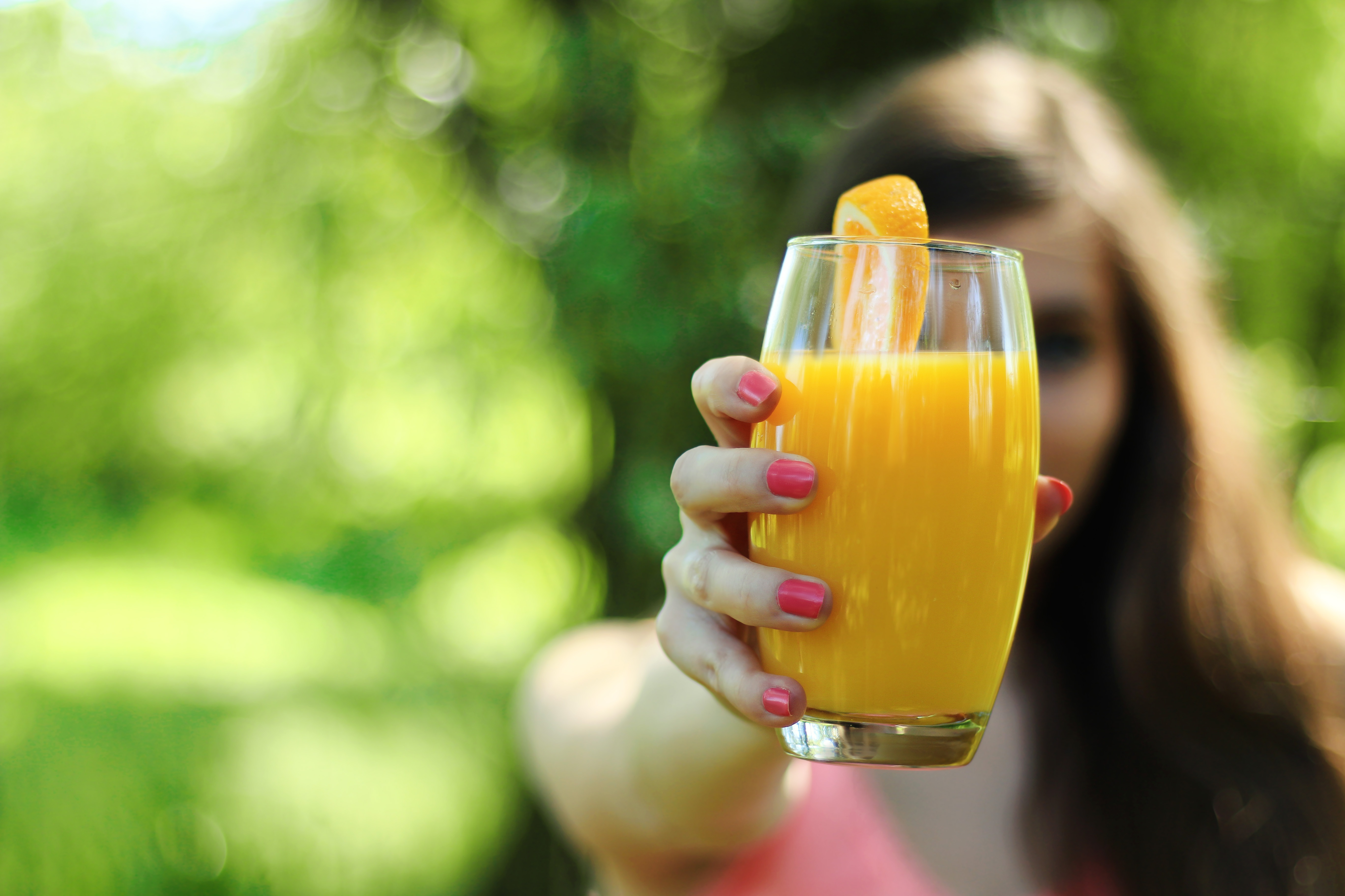 girl holding orange juice